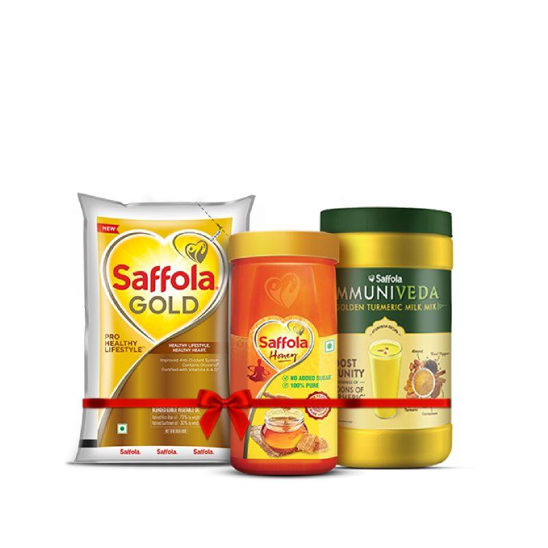 Saffola Gold 1L + 100% Pure Honey 500g + Turmeric Milk 400g