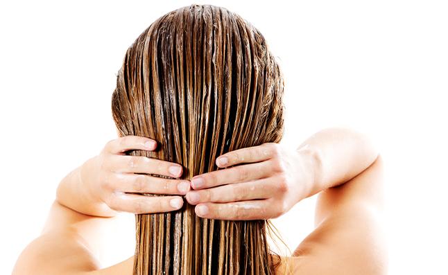 woman applying hair conditioner